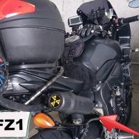 Auxiliary fuel bottle mounts on Givi rear rack